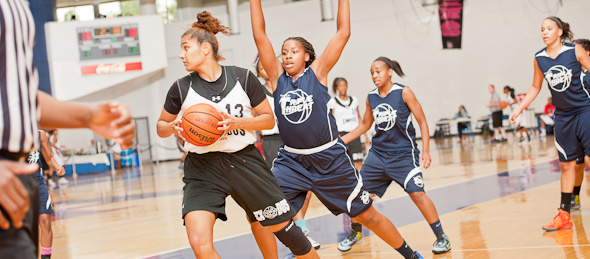 2014 post Lauren Moses of Mount Holly, N.J., (on defense) has risen into our ELITE 100 through her attention to detail on both ends of the floor. *Photo by Ty Freeman